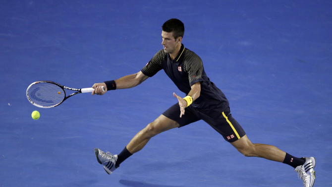 Serbia's Novak Djokovic reaches for a return to Spain's David Ferrer during their semifinal match at the Australian Open tennis championship in Melbourne, Australia, Thursday, Jan. 24, 2013.  (AP Photo/Rob Griffith)
