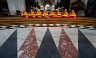 Monks chant ahead of the arrival of The Dalai Lama as he attends a ceremony in St Paul's Cathedral in central London