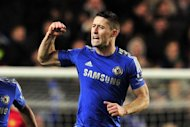 Chelsea's English defender Gary Cahill celebrates scoring their second goal during the English League Cup Fourth Round football match between Chelsea and Manchester United at Stamford Bridge in London. Chelsea won 5-4 in extra time