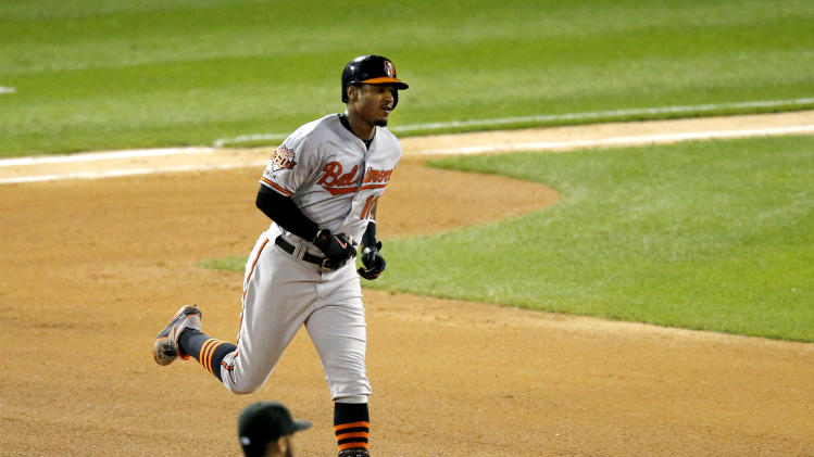 Baltimore Orioles' Adam Jones (10) rounds the bases past Chicago White Sox second baseman Leury Garcia, after hitting a home run off starting pitcher Hector Noesi, during the sixth inning of a baseball game Wednesday, Aug. 20, 2014, in Chicago. (AP Photo/Charles Rex Arbogast)