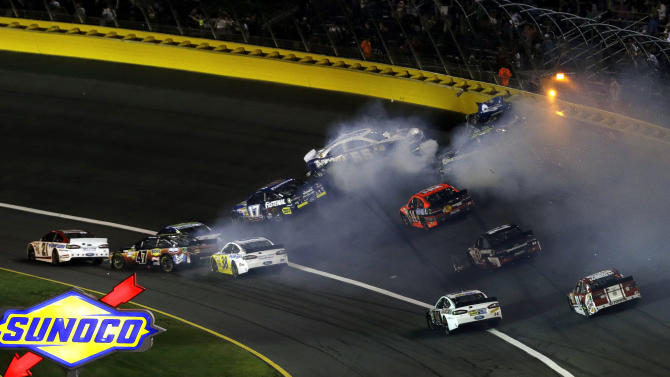 Multiple cars wreck in Turn 1 causing a second red flag during the NASCAR Sprint Cup Series Coca-Cola 600 auto race at the Charlotte Motor Speedway in Concord, N.C., Sunday, May 26, 2013. (AP Photo/Gerry Broome)