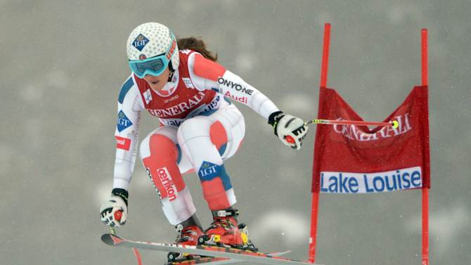 Tina Weirather, of Liechtenstein, speeds down the course in the women's World Cup downhill ski race in Lake Louise, Alberta, Friday, Nov. 30, 2012. (AP Photo/The Canadian Press, Jonathan Hayward)