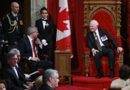 Canada's Prime Minister Stephen Harper (seated L) talks with Governor General David Johnston after Johnston delivered the Speech from the Throne in the Senate chamber on Parliament Hill in Ottawa October 16, 2013. REUTERS/Blair Gable (CANADA - Tags: POLITICS)