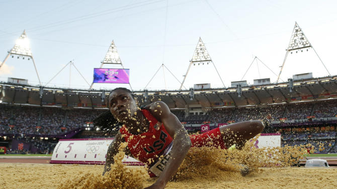 United States'  Brittney Reese competes in a women's long jump final during the athletics in the Olympic Stadium at the 2012 Summer Olympics, London, Wednesday, Aug. 8, 2012. (AP Photo/Matt Dunham)