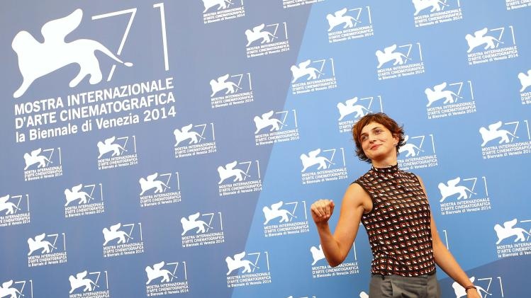 Italian film director Alice Rohrwacher, a member of the jury at the 71st Venice Film Festival, poses during a photo call for the event in Venice