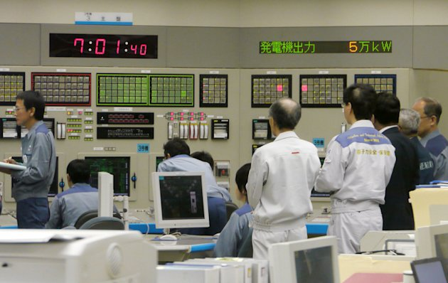 Technicians monitor at central control room of Ohi nuclear power plant in Ohi town, Fukui prefecture, western Japan after the No. 3 reactor began generating electricity in the first restart since last year&#39;s tsunami led to a nationwide nuclear power plant shutdown Thursday, July 5, 2012. (AP Photo/Kyodo News) JAPAN OUT, MANDATORY CREDIT, NO LICENSING IN CHINA, HONG KONG, JAPAN, SOUTH KOREA AND FRANCE