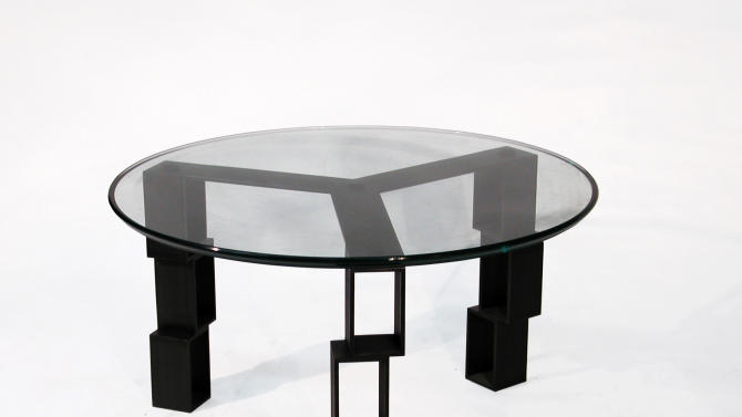 "This May 2011 image released by Work and Design shows Rafael Avramovich's ""Positive Space/Coffee Table,"" made of blacken steel finish with a circular glass top. (AP Photo/Work and Design, Rafael Avramovich)"