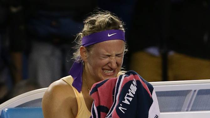Victoria Azarenka of Belarus reacts as she celebrates her win over China's Li Na in the women's final at the Australian Open tennis championship in Melbourne, Australia, Saturday, Jan. 26, 2013. (AP Photo/Aaron Favila)