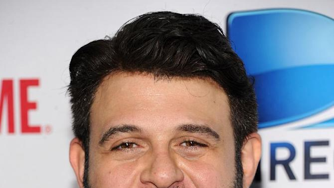 Adam Richman arrives at DIRECTV's Seventh Annual Celebrity Beach Bowl, on Saturday, Feb. 2, 2013 in New Orleans. (Photo by Evan Agostini/Invision/AP)