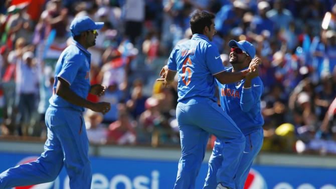 India's Mohit Sharma celebrates with team mates after catching out West Indies batsman Chris Gayle for 21 runs during their Cricket World Cup match in Perth