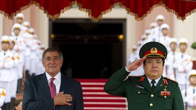 U.S. Secretary of Defense Leon Panetta, left,  participates in an arrival ceremony with Vietnam Minister of Defense Phung Quang Thanh at the Ministry of Defense in Hanoi, Vietman, Monday, June 4, 2012.  (AP Photo/Jim Watson, Pool)