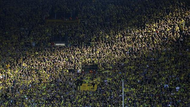 Supporters of Borussia Dortmund in the weekend Bundesliga match against Bayern (Reuters)