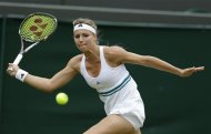 Maria Kirilenko of Russia plays a return to Agnieszka Radwanska of Poland during a quarterfinals match at the All England Lawn Tennis Championships at Wimbledon, England, Tuesday, July 3, 2012. (AP Photo/Kirsty Wigglesworth)