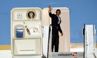 President Barack Obama waves goodbye as he enters Air Force One at JFK International Airport in New York, Thursday, Aug. 11, 2011, on his way back to Washington D.C. after two fundraisers in Manhattan (AP Photo/David Karp)