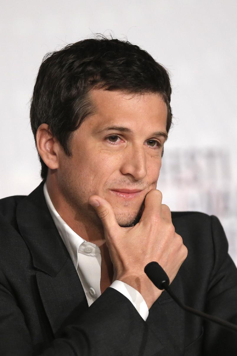 Director Guillaume Canet listens to questions during the press conference of Blood Ties at the 66th international film festival, in Cannes, southern France, Monday, May 20, 2013. (AP Photo/Francois Mori)