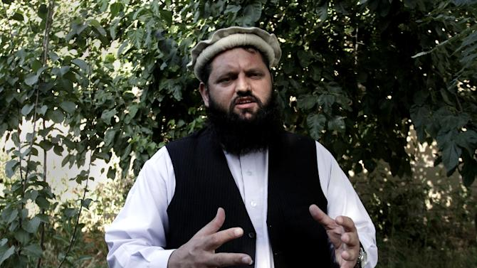 "Shafiullah Nooristani, a member of the Afghan High Peace Council, speaks during an interview with The Associated Press in Kabul, Afghanistan, Wednesday, June 19, 2013. Afghanistan President Hamid Karzai's said Wednesday he will not pursue peace talks with the Taliban unless the United States steps out of the negotiations, while also insisting the militant group stop its violent attacks on the ground after it claimed responsibility for a rocket attack that killed four Americans. Karzai had said Tuesday that he would send representatives from his High Peace Council to Qatar for talks but aides said he changed his mind after objecting to the Taliban's use of its formal name ""Islamic Emirate of Afghanistan"" in opening an office in Doha. (AP Photo/Rahmat Gul)"