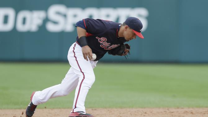 Atlanta Braves second baseman Jace Peterson charges the play during a spring training exhibition baseball game against the Boston Red Sox in Kissimmee, Fla., Friday, March 27, 2015. (AP Photo/Carlos Osorio)