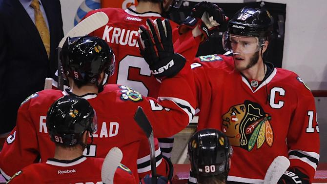 Chicago Blackhawks center Jonathan Toews, right, congratulates teammates after beating the Anaheim Ducks 5-2 in Game 6 of the Western Conference finals of the NHL hockey Stanley Cup playoffs, Wednesday, May 27, 2015, in Chicago. The Blackhawks won 5-2. (AP Photo/Charles Rex Arbogast)