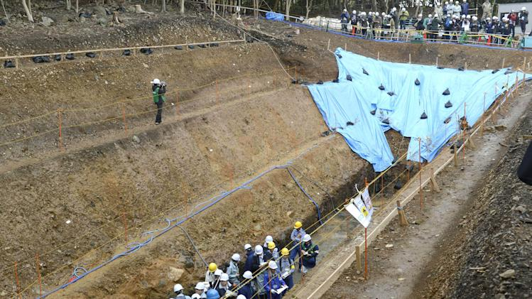 Japanese nuclear regulators inspect ground structures at the Ohi nuclear power plant to examine if an existing fault line is active, in Ohi, Fukui prefecture, western Japan, Friday, Nov. 2, 2012. The inspection determines whether the plant should close. Its No. 3 and No. 4 reactors went back online in July, becoming Japan's only operating reactors after all 50 Japanese reactors went offline for inspection following the March 11, 2011, crisis at Fukushima Dai-ichi. (AP Photo/Kyodo News) JAPAN OUT, MANDATORY CREDIT, NO LICENSING IN CHINA, FRANCE, HONG KONG, JAPAN AND SOUTH KOREA