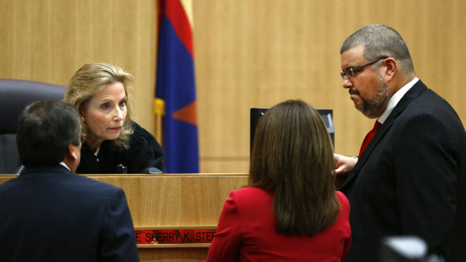 Judge Sherry Stephens meets with prosecutor Juan Martinez, left, and defense attorneys Jennifer Wilmott and Kirk Nurmi, right, after denying a motion for mistrial on Monday, May 20, 2013 during the penalty phase of Jodi Arias' murder trial at Maricopa County Superior Court in Phoenix, Ariz. Arias was convicted May 8, 2013 of first-degree murder in the stabbing and shooting to death of Travis Alexander, 30, in his suburban Phoenix home in June 2008. (AP Photo/The Arizona Republic, Rob Schumacher, Pool)