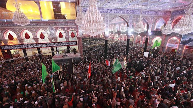 Shiite Muslim worshippers pray at the holy shrine of Imam Hussein during the Muslim festival of Arbaeen in Karbala, 50 miles (80 kilometers) south of Baghdad, Iraq, Wednesday, Jan. 2 , 2013. The holiday marks the end of the forty day mourning period after the anniversary of the 7th century martyrdom of Imam Hussein the Prophet Muhammad's grandson. (AP Photo/Hadi Mizban)