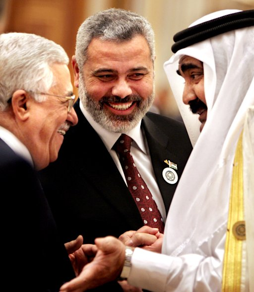 FILE - In this Thursday, March 29, 2007 file photo, Palestinian Authority President Mahmoud Abbas, left, Palestinian Prime Minister Ismail Haniyeh and Qatari leader, Emir Sheik Hamad bin Khalifa Al Thani share a laugh during the Arab summit in Riyadh, Saudi Arabia. Even as Qatar was helping mediate a unity accord with rival Palestinian factions, the prime minister of Hamas-ruled Gaza was leading his own tour through wealthy Gulf states. His tone was far more like a CEO than anti-Israel firebrand: meeting Gulf rulers and investment groups about pumping money into struggling Gaza. Haniyeh's trip coincided with breakthrough meetings in Qatar between Hamas leader Khaled Mashaal and Palestinian President Mahmoud Abbas on a unity accord to end the political estrangement between Gaza and the Abbas-governed West Bank. (AP Photo/Amr Nabil, File)