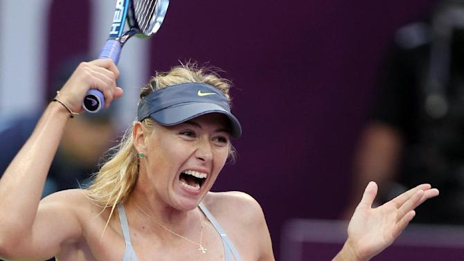 Maria Sharapova of Russia returns the ball to Samantha Stosur of Australia in the quarterfinal of the WTA Qatar Ladies Open tennis tournament in Doha, Qatar, Friday, Feb. 15, 2013. (AP Photo/Osama Faisal)