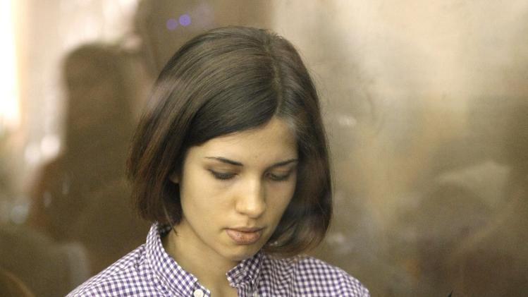 "Nadezhda Tolokonnikova, A member of feminist punk group Pussy Riot stands behind a glass wall at a court in Moscow, Russia,  Russia, Monday, July 30, 2012.Three members of the band are facing trial for performing a ""punk prayer"" against Vladimir Putin from a pulpit of Moscow's main cathedral before Russia's presidential election in March, in which he won a third term. (AP Photo/Mikhail Metzel)"