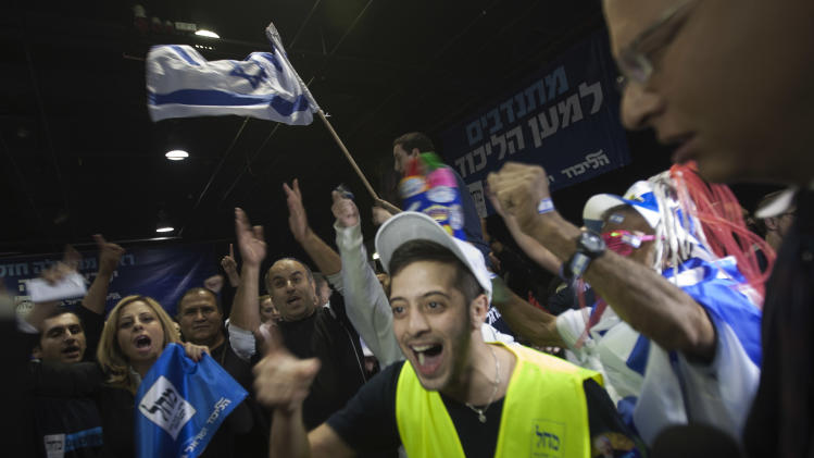 Supporters of the Israel's Prime Minister Benjamin Netanyahu celebrate in Tel Aviv, Israel, Tuesday, Jan. 22, 2013.  Israeli Prime Minister Benjamin Netanyahu's Likud Party is predicted to have the largest faction in a hotly contested parliamentary election on Tuesday, positioning the hard-liner to probably serve a new term as prime minister, according to exit polls. (AP Photo/Ariel Schalit)