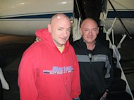 NASA astronaut Scott Kelly (left), Expedition 26 commander, is reunited with his twin brother, Mark Kelly on March 17, 2011, following a flight back to Ellington Field, Houston from Kustanay, Kazakhstan. Scott Kelly landed in Kazakhstan on Marc