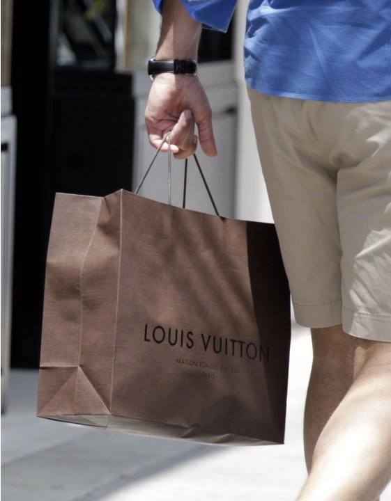 A shopping bag from the luxury brand Louis Vuitton is seen along Rodeo Drive in Beverly Hills