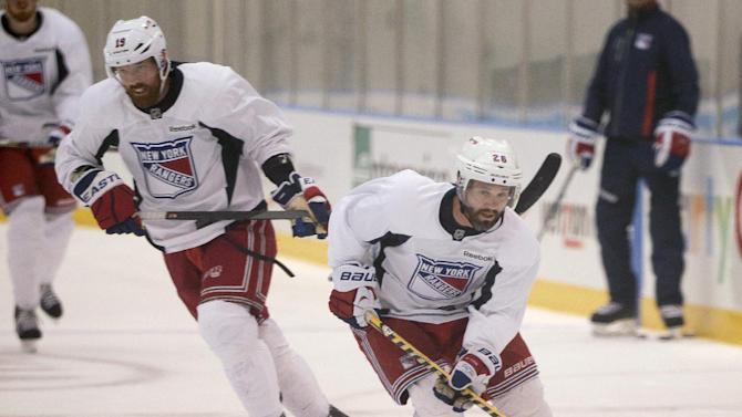 Rangers forwards Brad Richards and Martin St-Louis skate up ice during practice Monday in Greenburgh, N.Y. The Rangers face the Kings in the Stanley Cup final. (AP)