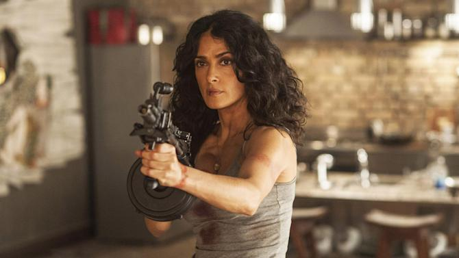 """This photo released by courtesy of Radius-TWC shows Salma Hayek in a scene from the film, """"Everly."""" (AP Photo/Radius-TWC)"""