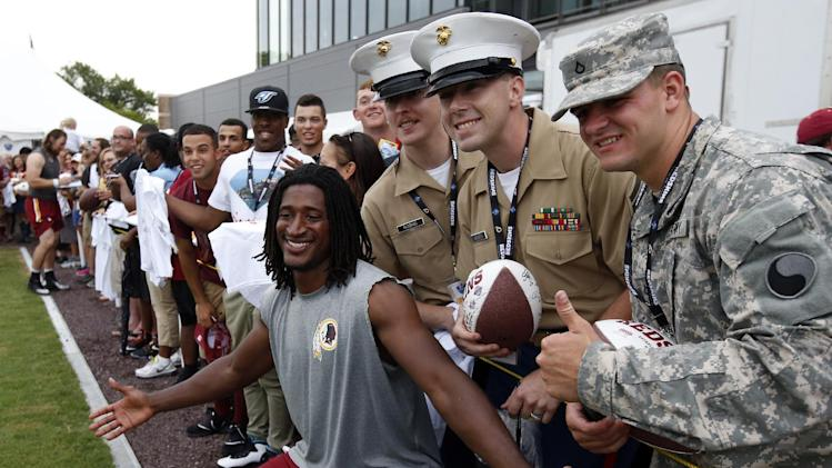 Washington Redskins receiver Andre Roberts poses for a picture with member of the military on Military Appreciation Day, after practice at the team's NFL football training facility, Sunday, July 27, 2014 in Richmond, Va