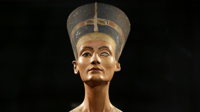 The Nefertiti bust is pictured during a press preview of the exhibition 'In The Light Of Amarna' at the Neues Museum (New Museum)  in Berlin, Germany, Wednesday, Dec. 5, 2012, The exhibition is to the 100th Anniversary of the discovery of the bust of the Nefertiti.  (AP Photo/Michael Sohn, pool)