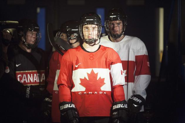 2014 Sochi Olympics: Minor hockey players wear new Team Canada jerseys, during event announcing new design.