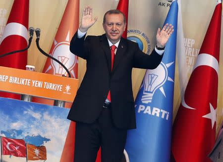 Turkey's Prime Minister Tayyip Erdogan greets his supporters during the Extraordinary Congress of the ruling AK Party in Ankara