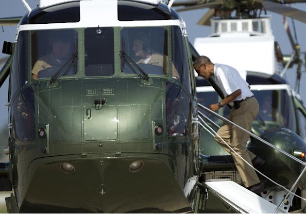 President Barack Obama boards Marine One helicopter as he departs Andrews Air Force Base, Md., for Camp David, Saturday, Aug. 4, 2012.  President Obama celebrated his 51st birthday Saturday with a rou