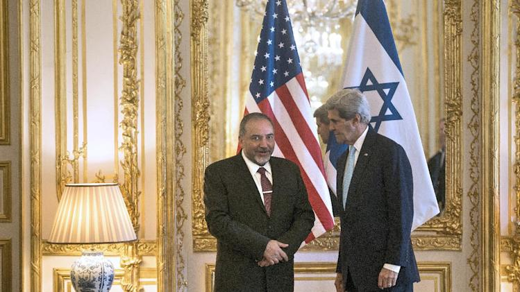 US Secretary of State John Kerry (R) and Israeli Foreign Minister Avigdor Lieberman in Paris on June 26, 2014