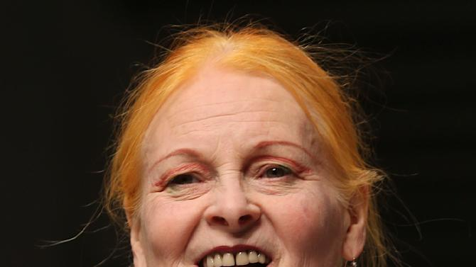 British designer Vivienne Westwood smiles on the catwalk at the end of her men's Spring-Summer 2014 fashion show, part of the Milan Fashion Week, unveiled in Milan, Italy, Sunday, June 23, 2013. On her dress she pinned a photo of US Army soldier Bradley Manning, who was arrested in 2010 on suspicion of having made public classified material through the website WikiLeaks. (AP Photo/Luca Bruno)
