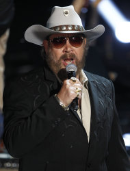 "FILE - This May 12, 2011 file photo shows singer Hank Williams Jr. performs during the CMT Disaster Relief Concert in Nashville, Tenn. Williams latest album, ""Old School, New Rules,"" will be released on Tuesday, July 10, 2012. The 12-song record features guest appearances from Merle Haggard and Brad Paisley. (AP Photo/Wade Payne, file)"
