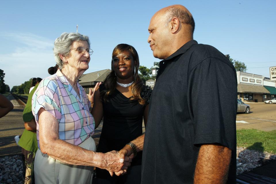 A resident greets Charles and Te'Andrea Wilson following a prayer rally in downtown Crystal Springs, Miss., in support of racial reconciliation Monday, July 30, 2012 following the actions of some congregants at the First Baptist Church which prevented the black couple from getting married there. (AP Photo/Rogelio V. Solis)