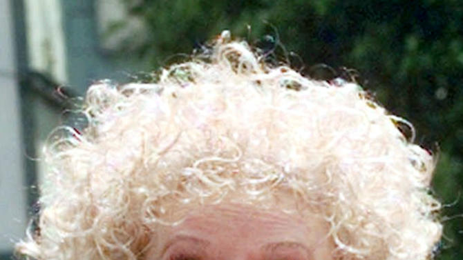 FILE-In this May 17, 1999 file photo, Phyllis Diller laughs in the Hollywood section of Los Angeles. Diller, the housewife turned humorist who aimed some of her sharpest barbs at herself, died Monday, Aug. 20, 2012, at age 95 in Los Angeles. (AP Photo/Nick Ut, File)