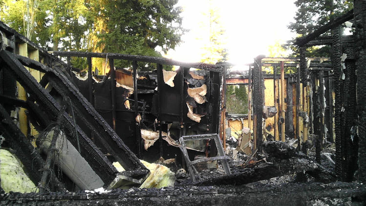 This undated evidence photo provided Monday, May 20, 2013, by the West Valley City Police Department shows the rental home in Graham, Wash., that burned to the ground when Josh Powell killed himself and his two young sons on Feb. 5, 2012. Newly released police records show that Utah officials believe Josh Powell likely killed his wife and that his brother, Michael Powell, helped dispose of the body, but authorities felt they didn't have enough evidence to prove that theory in court. The documents, released late Monday, gave the public its first glimpse into what police knew of Susan Powell's 2009 disappearance. (AP Photo/West Valley City Police Department)