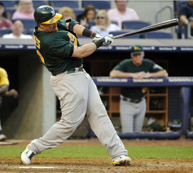 Oakland Athletics' Jonny Gomes hits a two-run home run during the 13th inning of a baseball game against the New York Yankees, Saturday, Sept. 22, 2012, at Yankee Stadium in New York. (AP Photo/Bill K