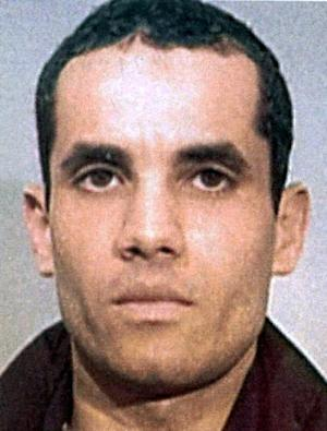 """UNDATED FILE PHOTO-In this undated police handout file photo, Algerian Ahmed Ressam is pictured.  Ressam was arrested near the U.S.-Canadian border and convicted of plotting to bomb Los Angeles International Airport at the turn of the millennium. A federal appeals court has overturned the 22-year sentence for Ressam, the convicted """"millennium bomber"""", calling it unreasonably lenient. The 9th U.S. Circuit Court of Appeal ruled 7-4 in favor of the government's appeal in a decision released Monday March 12,2012. (AP Photo/Canadian Press, Police Handout via Le Journal de Montreal,File)"""