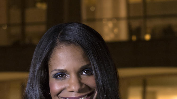 "In this photo provided by ""Live from Lincoln Center,"" Broadway star Audra McDonald poses for a portrait in front of the Lincoln Center in New York. PBS said Tuesday, Nov. 27, 2012, that the singer-actress is the new host of ""Live from Lincoln Center."" McDonald will emcee seven broadcasts from December through spring 2013, starting Dec. 13 with ""The Richard Tucker Opera Gala."" (AP Photo/Live from Lincoln Center, Chase Newhart)"