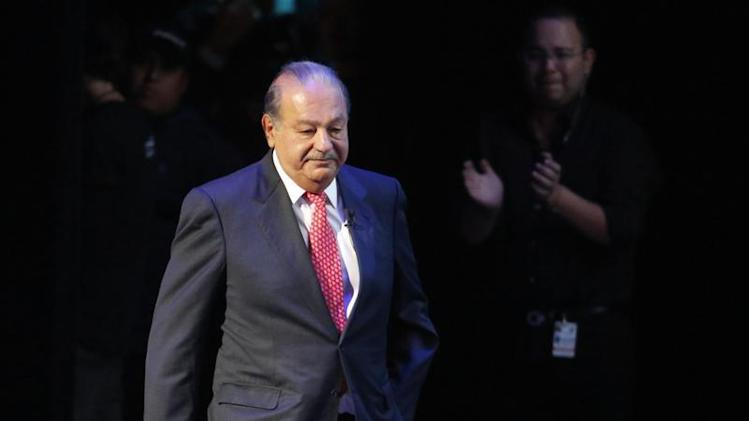Mexican billionaire Carlos Slim walks on stage in Mexico City