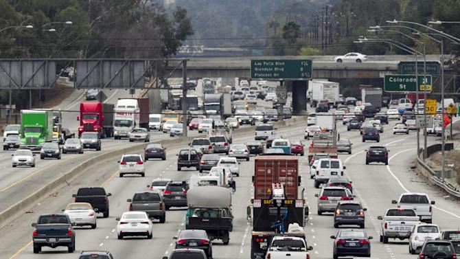 In this Thursday, Feb. 6, 2014 photo, late morning traffic travels on Interstate 5, in Los Angeles. In California, I-5 in Los Angeles County is the most congested route, according to new data from the California Department of Transportation. (AP Photo/Damian Dovarganes)