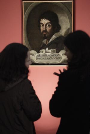 """FILE - In this Thursday, Feb. 10, 2011 file photo visitors admire the portrait of Caravaggio by an unknown painter during the presentation to journalists of an exhibit dedicated to the Lombard painter titled: """"Caravaggio in Rome"""", in Rome. Two Italian art historians are claiming, Thursday, July 5, 2012, to have identified dozens of drawings as those of a very young Caravaggio in a collection of works of a master painter he studied under in the late 1500s. There was no immediate way to verify the claim. One noted expert of 16th century art familiar with the drawings said it was likely that at most only a few were done by Caravaggio, but that in any case none show the mature hand of the artist. (AP Photo/Pier Paolo Cito, File)"""
